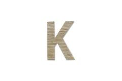 Английский алфавит k сделанный от изолированной древесины на белой предпосылке Стоковая Фотография
