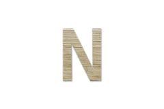 Английский алфавит n сделанный от изолированной древесины на белой предпосылке Стоковая Фотография RF