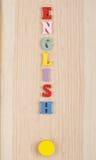 Английское слово на деревянной предпосылке составленной от писем красочного блока алфавита abc деревянных, космосе экземпляра для Стоковое Фото