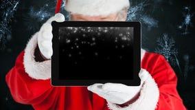 Анимация цифров видео на цифровом планшете показывая хлопья снега сток-видео