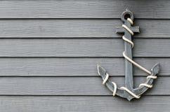 Анкер на деревянной стене Стоковое Фото