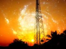 Антенна приема с оранжевым небом Стоковые Изображения