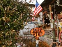 Антиквариат знака автобусной остановки Американа Стоковые Фотографии RF