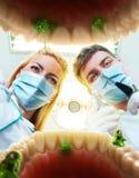 2 дантиста рассматривая зубы Стоковая Фотография RF