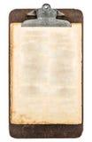 Античная доска сзажимом для бумаги с листом постаретой grungy бумаги Стоковые Изображения RF