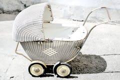 Античная прогулочная коляска Стоковая Фотография