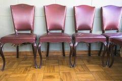 Античные красные обитые стулья стоковая фотография rf