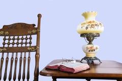 Античные кресло-качалка и библия стоковое фото rf