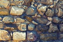 Античные старые естественные каменная стена, предпосылка, текстура или картина Деревенская текстура Стоковое Изображение RF