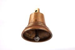 Античный медный малый колокол на белой предпосылке Стоковые Фото