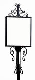 Античный чугунный знак для объявлений с белой предпосылкой Стоковое Изображение