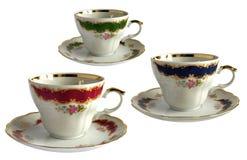 3 античных чашки и поддонника фарфора Стоковые Фото