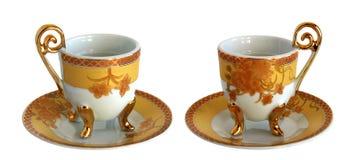 2 античных чашки и поддонника фарфора Стоковая Фотография