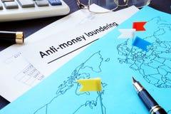 Анти--деньги Laundering документы AML и карта мира стоковое фото rf