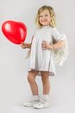 Анджел с красным сердцем Стоковое фото RF