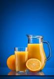 Апельсиновый сок над синью Стоковые Изображения