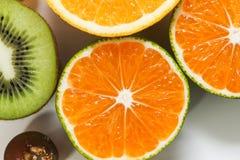 Апельсины, кивиы и виноградины Стоковое Изображение RF