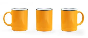 Апельсин и белизна кружки кофе Модель-макет кружки пустой Стоковое фото RF