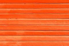 Апельсин покрасил деревянные предпосылку, текстуру или стену стоковое фото rf
