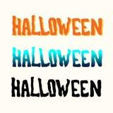 Апельсин, синь, черное название хеллоуина на белизне стоковое изображение