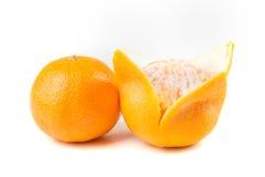 2 апельсина пупка одного слезли одно unpeeled Стоковые Фотографии RF