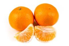 3 апельсина пупка одного слезли 2 unpeeled Стоковые Изображения