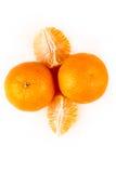 3 апельсина пупка одного слезли 2 unpeeled Стоковое Изображение RF
