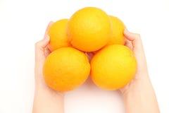 Апельсины в руке Стоковые Фото