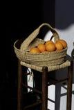 Апельсины и корзина Стоковое фото RF
