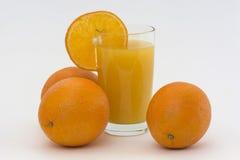 Апельсины и этап с соком Стоковые Фото