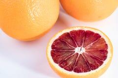 Апельсины крови на белой предпосылке Стоковые Изображения