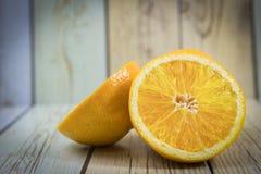 Апельсины на деревянном Стоковые Фотографии RF