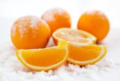 Апельсины на снеге Стоковые Фото