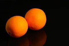 Апельсины на темной предпосылке Стоковые Фото
