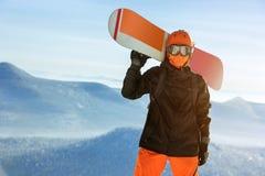 Апельсин верхней части горы портрета сноуборда Snowboarder Стоковые Изображения