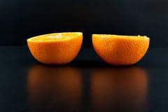 Апельсин изолированный на черной предпосылке Стоковая Фотография RF