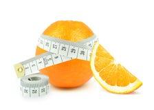 Апельсин и метр стоковое фото rf