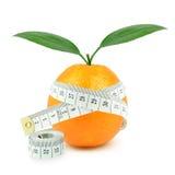 Апельсин и метр стоковое фото