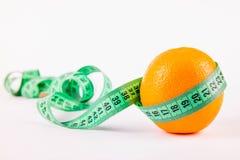 Апельсин и метр Стоковая Фотография