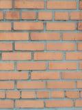 Апельсин, коричневая стена сделанная кирпича для предпосылок и текстуры Стоковое Фото