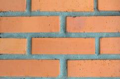 Апельсин, коричневая стена сделанная кирпича для предпосылок и текстуры Стоковая Фотография