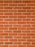 Апельсин, красный цвет bricked стена Стоковое Изображение RF