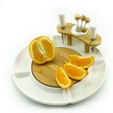 Апельсин на блюде Стоковые Изображения