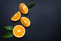 Апельсин на черной предпосылке Стоковое Фото