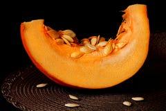 Апельсин на черноте Стоковая Фотография