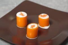 Апельсин свертывает с красной икрой молекулярная кухня Стоковое фото RF