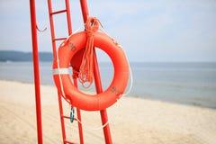 Апельсин спасательного оборудования пляжа личной охраны lifebuoy Стоковое Изображение
