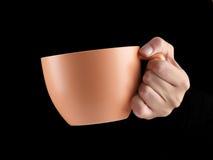 Апельсин - чашка цвета абрикоса - кружка на черной предпосылке Стоковая Фотография