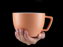 Апельсин - чашка цвета абрикоса - кружка на черной предпосылке Стоковые Изображения RF