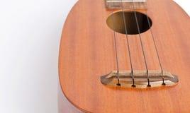 Аппаратура музыки гавайской гитары на белой предпосылке Стоковое фото RF